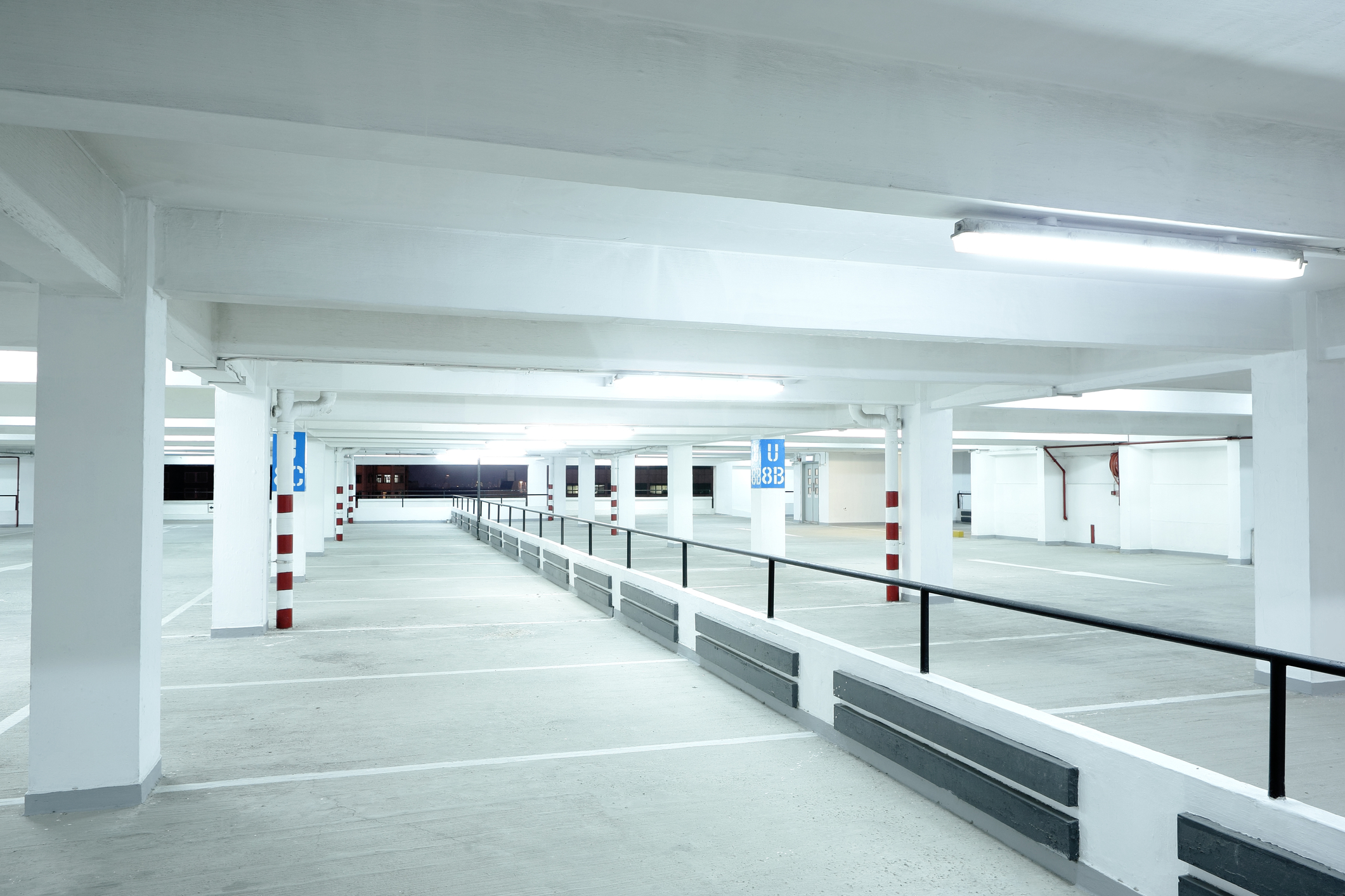 Empty well lit car park. white lights